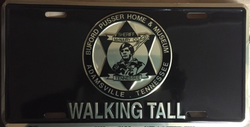 Special edition museum license plate, black with gold print of the Buford Pusser Museum logo.